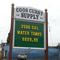 Coos Curry Supply sign